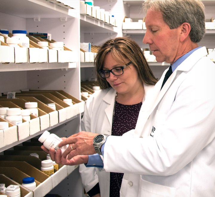Pharmacists pulling medication from the shelf